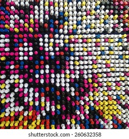 Pins are arranged in several colors.