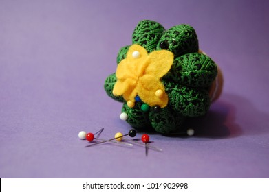 Pins and cactus shaped pin cushion
