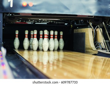 Pins at the end of a bowling alley,Skittles for bowling,bowling game