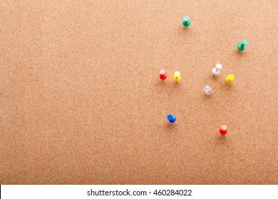 Pins on brown cork board