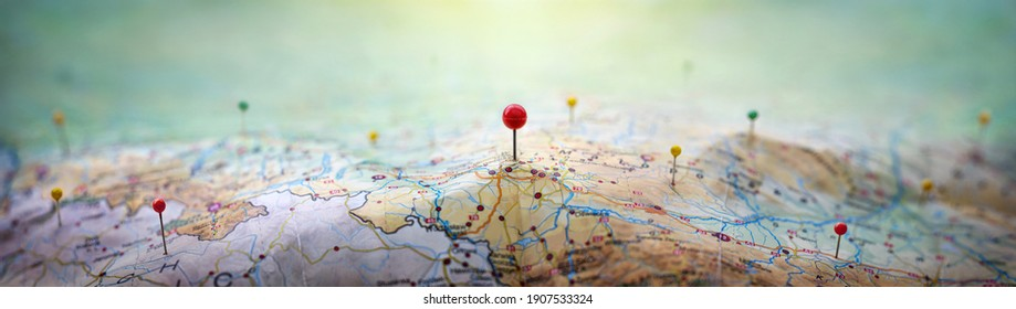 Pins on geographic map curved like mountains. Pinning a location on map with mountains. Adventure, discovery, navigation, geography, mountaineering, rock climbing, hike  and travel concept background.