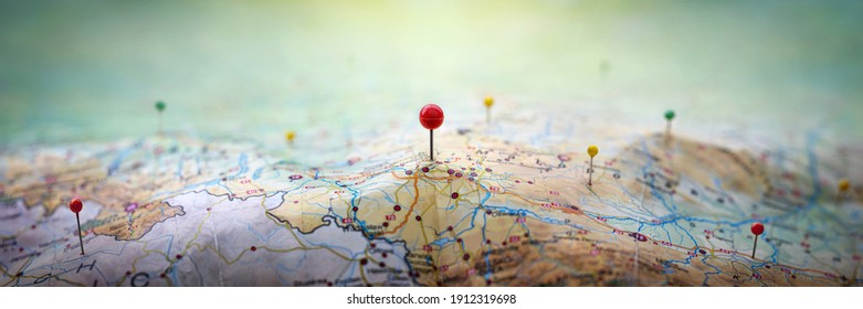 Pins on geographic map curved like mountains. Pinning a location on map with mountains. Adventure, discovery, navigation, geography, mountaineering, rock climbing, hike  and travel concept background