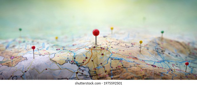 Pins on geographic map curved like mountains. Pinning  location on map with mountains. Adventure, discovery, navigation, geography, mountaineering, rock climbing, hike  and travel concept background.
