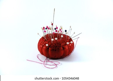 pins to sew in a red pillow isolate on white background.