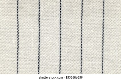 Pinstripes are thin, vertical grey, blue stripes. White linen with virgin wool. Natural Visible weave texture. Summer. Expensive men's suit. High resolution
