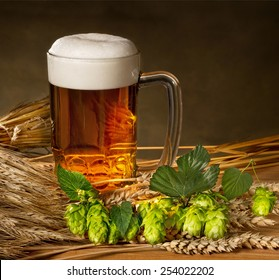 pint of beer with hops and barley