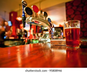 Pint of beer on a bar in a traditional style English pub