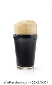 pint of dark beer isolated on white background