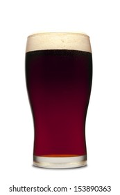 A pint of dark beer isolated on white.