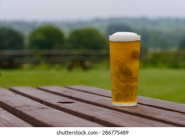 pint of lager beer on country pub beer garden table