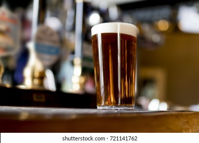 Pint of real ale on the bar in a traditional English pub