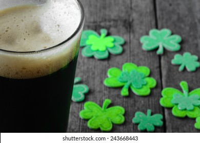 Pint of Stout Beer with Green Shamrock