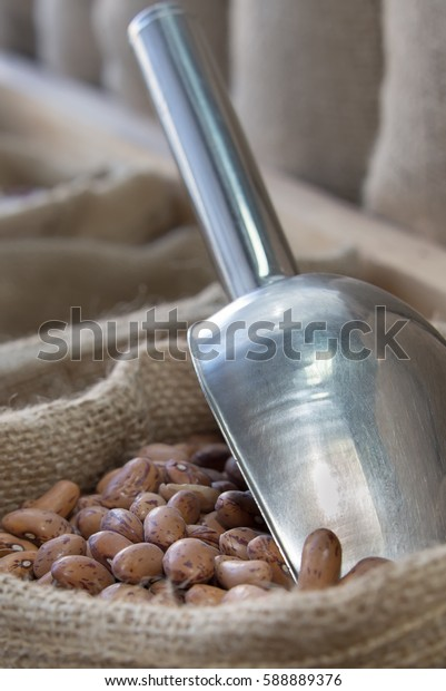Pinto beans in a bag of hemp arranged to stand in a store. Selective focus.