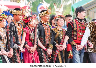 Pintung, Taiwan-January 27, 2012:  Paiwan People in Beautiful Traditional Dress (Aboriginal Tribe) Dancing at the Wedding Ceremony in Taiwu Village