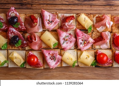 Pintxos, tapas, spanish canapes party finger food background.