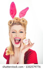 Pin-up Easter. Sexy woman in bunny ears winking. Sweet adorable girl in bunny ears celebrating Easter. Isolated white background. Woman wearing Easter bunny ears and looks very sensually