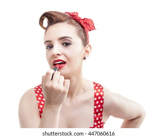 Pin-up girl applying red lipstick on the lips, isolated over white background