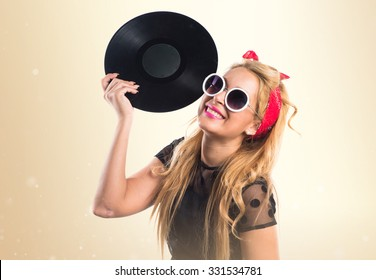 Pin-up girl holding a vinyl
