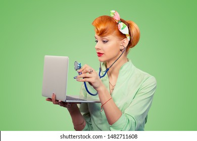 Pinup girl listening computer with stethoscope looking at pc vintage hairstyle green background Healthcare diagnosis software repair diagnostics internet threat security safety problem solving concept