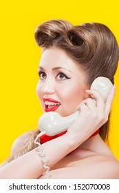 Pin-up girl talking on retro telephone