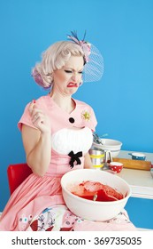 A pinup girl tastes her cake batter and finds out it tastes horrible.