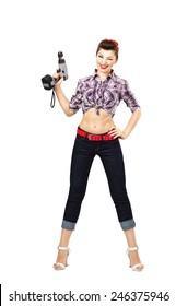 Pinup,  rockabilly desperate housewife with cordless screwdriver, smiling and winking to you.