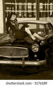 pin-up style model on a 50s car