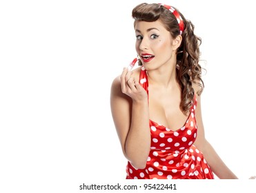 Pin-up  woman applying her make-up