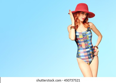PinUp woman in fashion Beach swimsuit. Playful Sexy Redhead Model girl in Summer Stylish Outfit, Hat. Slim  body, Trendy Unusual Creative