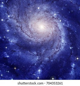 Pinwheel Galaxy, also known as M101; a spiral galaxy about twenty-one million light years away near the constellation of Ursa Major. Retouched colored image. Elements of this image furnished by NASA.