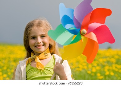 Pinwheel -  girl with colored pinwheel