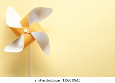 pinwheel on yellow background