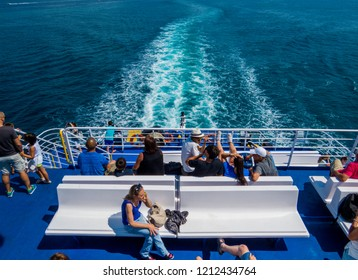 PIOMBINO, ITALY - JULY 28, 2018: People on the ferry boat from Piombino to the Elba island.