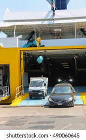 Piombino, Italy - June 30, 2015: Unloading vehicles from ferry boat Corsica Express in the seaport