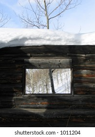 pioneer cabin in the snow