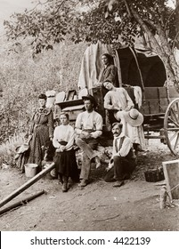 Pioneer settlers, homesteaders, covered wagon - circa 1890 vintage photo