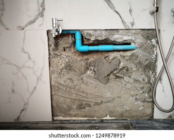 Pipe in bathroom wall