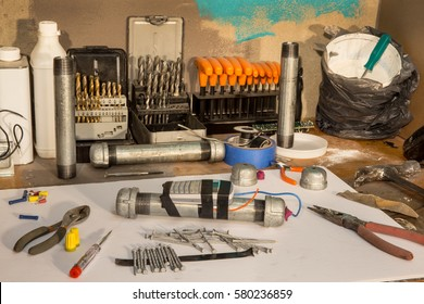 Pipe bomb makers workshop with tools
