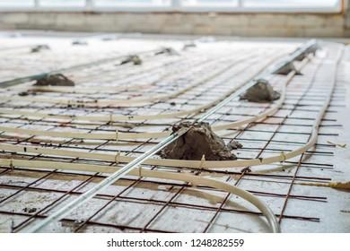 Pipe fitter mounted underfloor heating. Heating system and underfloor heating