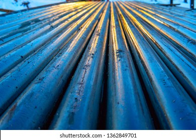 Pipe metal texture. Drillpipe on Oil Rig Pipe Deck. Rusty drill pipes were drilled in the well section.