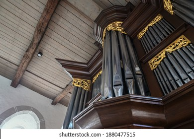 Pipe organ case facade in dark wood with golden decorations in St. Mary's Church of the village Gudow, Schleswig-Holstein, Germany, selected focus, narrow depth of field - Shutterstock ID 1880477515