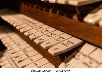 Pipe organ keyboard controls close up vintage style in english