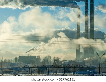 Pipe with smoke. Heat energy network. CHP. combined heat and power, a system in which steam produced in a power station as a byproduct of electricity generation is used to heat nearby buildings.
