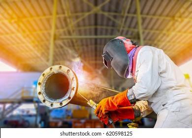 pipe welding, welder Industrial automotive part in factory, welding man work in work shop