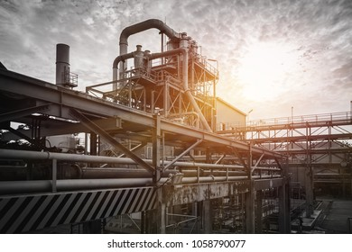 Pipeline and pipe rack of industrial plant with sunset sky background, Manufacturing of industrial plant with monotone