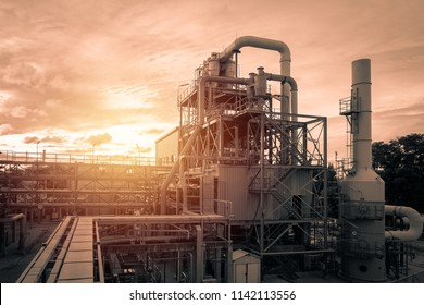 Pipeline and pipe rack of industrial plant with sunset sky background, Manufacturing of polymer industrial plant with monotone