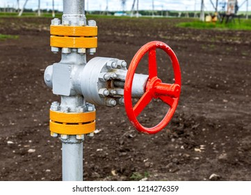 Pipeline with red control valve. Oil industry equipment