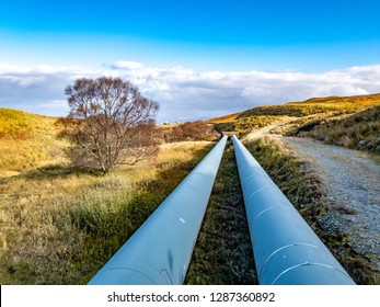 Pipeline of the Storr Lochs hydroelectric power station nestled under the mountains of the Trotternish Peninsula on the Isle of Skye in the West Highlands of Scotland - UK.