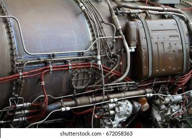 Pipelines and electric cables on the body of a modern aircraft engine.