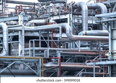 Pipelines and petrochemical industrial plant towers view of oil and gas refinery